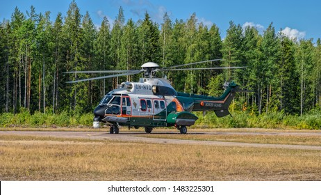 KOTKA, FINLAND - Aug 10, 2019: Airbus Helicopters H215 (formerly Eurocopter AS332 Super Puma) heavy-lift utility aircraft OH-HVP by Finland's Border Guard taxiing on runway at Karhula airshow.