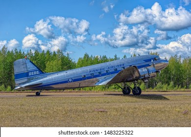 KOTKA, FINLAND - Aug 10, 2019: Short-haul transport aircraft with two piston engines Douglas DC-3A-447 OH-LCH Airveteran in Finnish Airlines livery landing on Karhula aviation museum airshow.