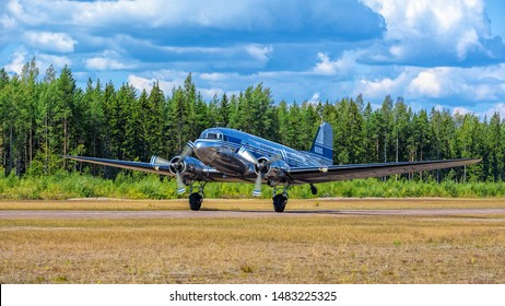 KOTKA, FINLAND - Aug 10, 2019: Short-haul transport aircraft with two piston engines Douglas DC-3A-447 OH-LCH Airveteran in Finnish Airlines livery take off from Karhula aviation museum airshow.