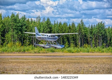 KOTKA, FINLAND - Aug 10, 2019: Single-engined piston-powered aircraft with fixed landing gear Cessna T206H Turbo Stationair OH-PAX amphio floats take of from Karhula aviation museum airshow.