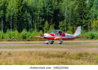 KOTKA, FINLAND - Aug 10, 2019: Two-seat single-engined piston-powered special light sport aircraft Evektor-Aerotechnik EV97 Eurostar OH-U556 landing on Karhula aviation museum airshow.