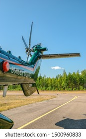 KOTKA, FINLAND - Aug 10, 2019: Tail rotor and wing of Airbus Helicopters H215 (formerly Eurocopter AS332 Super Puma) heavy-lift utility aircraft OH-HVP by Finland's Border Guard against blue sky.