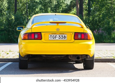 Kotka, Finland - July 16, 2016: Bright Yellow Facelift Toyota Celica GT liftback T200 model of 1994-1999, close up rear view