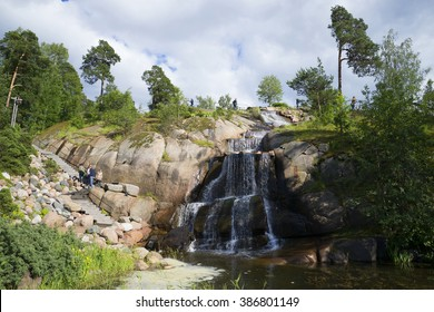 KOTKA, FINLAND - JUNE 21, 2014: A view of the man-made waterfall in the park Sapokka