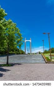 "KOTO, TOKYO / JAPAN - JULY 26 2019 : Scenery of ""Kiba Park"" in Koto-ku, Tokyo. It is a vast park where many trees are planted. The big bridge called ""Kiba Park Big Bridge"" is the symbol of the park."
