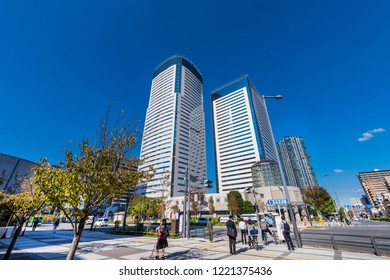 """KOTO, TOKYO / JAPAN - OCTOBER 22 2018 : Scenery of a skyscraper in front of """"Toyosu"""" station. """"Toyosu Center Building"""" and many other office buildings are built."""