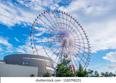"""KOTO, TOKYO / JAPAN - SEPTEMBER 9 2018 : Scenery in front of """"Aomi station"""" in Odaiba. There is a """"Palette Town"""" of a commercial facility. The large Ferris wheel is a symbol of Odaiba."""