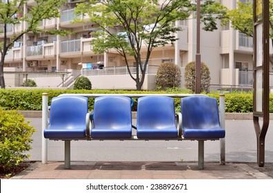 KOTO, TOKYO - JULY 21, 2013: Blue plastic benches of bus stop. This bus stop belongs to Bureau of Transportation Tokyo Metropolitan Government.