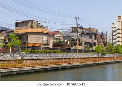Koto-ku, Tokyo, Japan. April 20, 2018. A range of Japanese houses from semi-traditional to modern. They over look the Onagi River in eastern Tokyo.