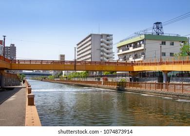 Koto-ku, Tokyo, Japan. April 20, 2018. A wooden pedestrian bridge built in a semi-traditional style. It spans the river Onagi in eastern Tokyo.