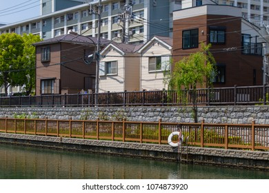 Koto-ku, Tokyo, Japan. April 20, 2018. 3 different styles of Japanese houses over look the Onagi River in eastern Tokyo.