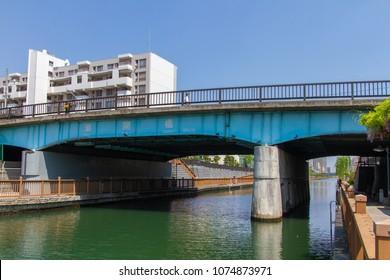 Koto-ku, Tokyo, Japan. April 20, 2018. The Shinkai Bashi Bridge over the river Onagi in Eastern Tokyo.