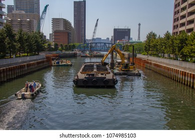 Koto-ku, Tokyo, Japan. April 20, 2018. Dredging in the Onagi River in eastern Tokyo. The sediment in the river is still contaminated from 20th century pollution.