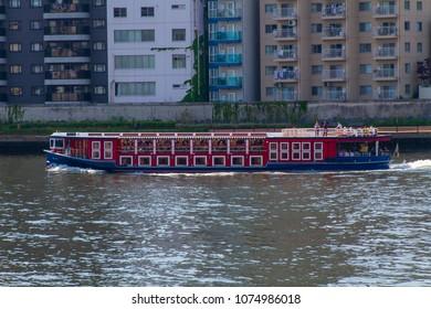 Koto-ku, Tokyo, Japan. April 20, 2018. A tourist sightseeing boat on the Sumida River in eastern Tokyo.