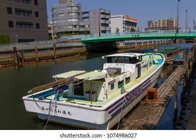 Koto-ku, Tokyo, Japan. April 20, 2018. A boat tied up to a dilapidated wooden dock in the Onagi River in Tokyo.