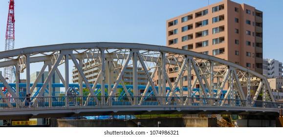 Koto-ku, Tokyo, Japan. April 20, 2018. The Momatsu Bashi Bridge on the Onagi River. This steel truss bridge was completed in 1930.
