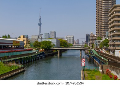 Koto-ku, Tokyo, Japan. April 20, 2018. Looking north up the Yokojikagawa Canal, also known as the Tenjin River. The canal construction was started in 1659 by Tokuyama Yamazaki.