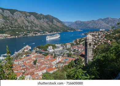 KOTOR, MONTENEGRO - 13TH AUGUST 2016: A view of the Kotor skyline during the day in the summer. A cruise liner can be seen in the water.