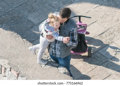 Kotor, Montenegro, April 28, 2017:  Father dancing with his little daughter on the street