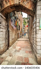 Kotor, Montenegro - August 06, 2014: Narrow street of the old city in Kotor, Montenegro