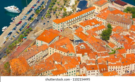 Kotor, Montenegro. Beautiful aerial view of Ancient town Kotor located in Boka Kotorska bay on the Adriatic sea in summer sunny day. The old town is under UNESCO protection