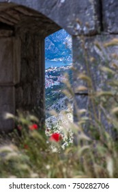 KOTOR, MONTENEGRO - CIRCA JUNE 2017 - Looking out through thick, stone defensive walls to Perast and the Gulf of Kotor from ruins of a Fortress near the top of Kotor's Old City Walls