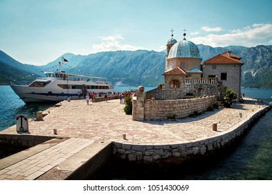 Kotor, Montenegro - July 02 2015. Floating Church of Montenegro. Our Lady of the Rocks Church  People go ashore from a cruise liner to the island  in the Adreatic sea