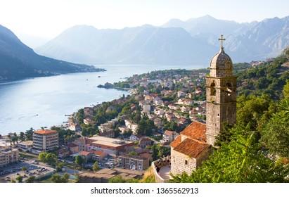 Kotor, Montenegro - July 11, 2015:  Venetian fortress of St. John and Chapel of Salvation of Virgin on Mount Pestingrad against picturesque bay. Kotor. Montenegro