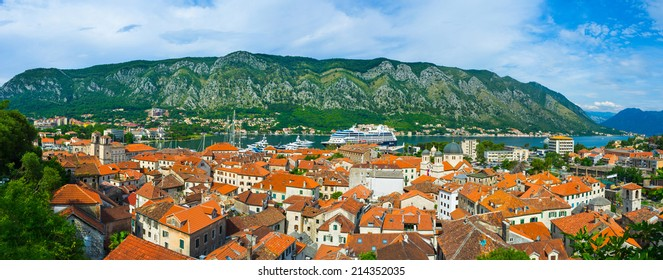 KOTOR, MONTENEGRO - JULY 15, 2014: Panorama of the Kotor bay and the roofs of the old town with the great mountains on the background, on July 15 in Kotor.