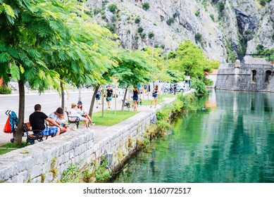 KOTOR, MONTENEGRO - July 17, 2018: people resting in city park near kotor gate in montenegro. summer travel concept