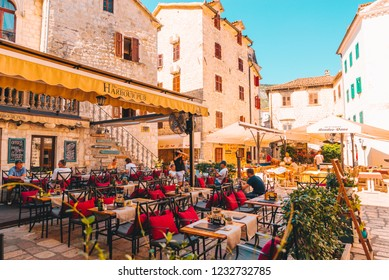 KOTOR, MONTENEGRO - July 20, 2018: people eating in kotor cafe