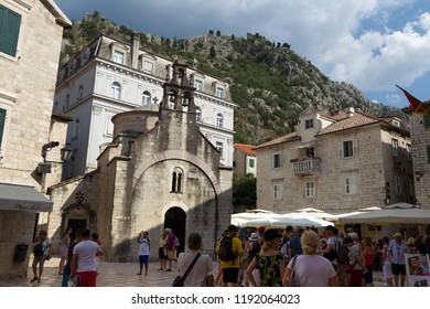 KOTOR, MONTENEGRO - July 25, 2018: Tourists in the Old Town of Kotor. Kotor is a city on the coast of Montenegro and is located in Kotor Bay.