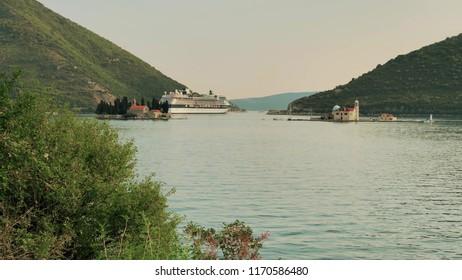 KOTOR, MONTENEGRO - JULY 27, 2018. GTS Celebrity Constellation cruise ship leaving the Bay of Kotor or Boka Kotorska