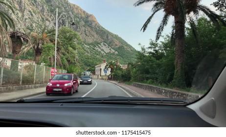 KOTOR, MONTENEGRO - JULY 27, 2018. POV driving shot of the Bay of Kotor or Boka Kotorska road