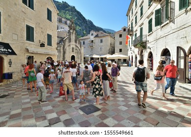 Kotor, Montenegro - June 10. 2019. Group of tourists near the church of St. Luke in the Old Town Square