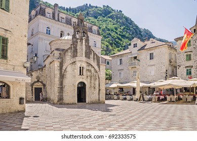 Kotor, Montenegro - June 8, 2017: Saint Luke square with the St.Lukas one-nave church, built by Mauro Kacafrangi in 1195, example of the Romanesque and Byzantine architecture in the old town of Kotor.