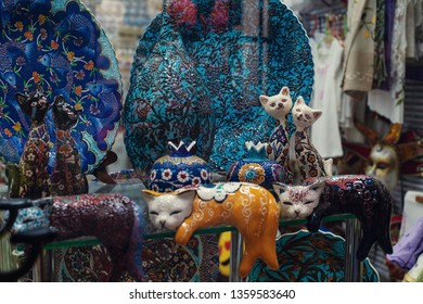 Kotor, Montenegro. March 2019: Souvenirs selection from old town Souvenir trade - various figures of cats (symbol of the town) and funny fish.