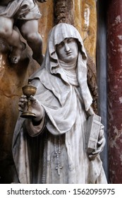 KOTOR, MONTENEGRO - MAY 02, 2019: Saint Clare of Assisi, statue on the High Altar in the Catholic Church of the Saint Clare in Kotor, Montenegro