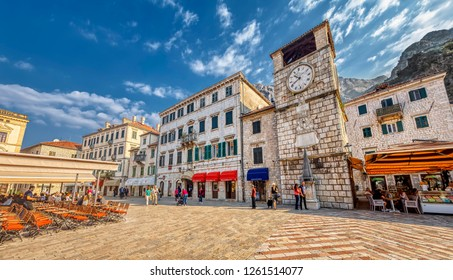 KOTOR, MONTENEGRO - OCTOBER 20, 2018: The clock tower is seen at Trg od oruzja (Square of the Arms) on October 20, 2018 in Kotor, Montenegro.