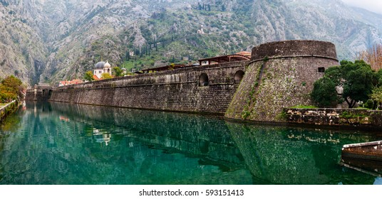 Kotor, Montenegro. Old fortress of Kotor, Montenegro in late Autumn. Tower and wall, mountain at the background