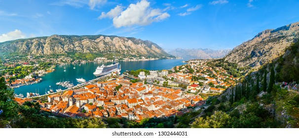 Kotor, Montenegro - September 14 2018: A panoramic view of the Bay of Kotor, cruise port, mountains and the medieval walled old town from the ruins of the Castle of San Giovanni