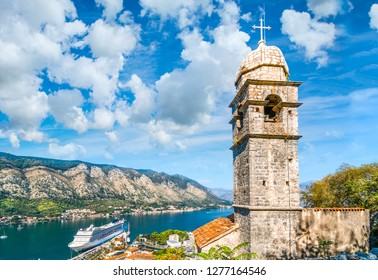 Kotor, Montenegro - September 16 2018: The tower of Saint John Church, under the ruins of the Castle Fortress of San Giovanni, overlooking the Bay of Kotor in Kotor, Montenegro