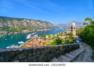 Kotor, Montenegro - September 16 2018: Steep steps reach the tower of Saint John Church, part of the ruins of the Castle Fortress of San Giovanni, overlooking the Bay of Kotor in Kotor, Montenegro