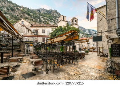 Kotor, Montenegro - September 17 2018: An outdoor sidewalk cafe sits empty early in the morning near the Kotor Cathedral in the fortified medieval city of Kotor Montenegro.