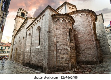 Kotor, Montenegro - September 18 2018: Locals and tourists walk the narrow back streets behind the Kotor Cathedral of Saint Tryphon in the ancient city of Kotor, Montenegro.