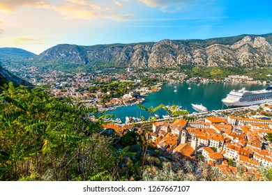 Kotor, Montenegro - September 18 2018: A large cruise ship is seen from the castle hill ruins on the mountainside as it docks in the Bay of Kotor, or Boka, on the adriatic coast of Kotor, Montenegro.