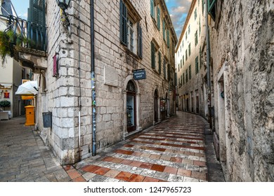 Kotor, Montenegro - September 19 2018: Small shops and cafes line a picturesque medieval street in the old town district of the coastal city of Kotor, Montenegro, on the Adriatic Coast.