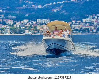 KOTOR, MONTENEGRO - SEPTEMBER 2, 2018. Tourists on a speed boat in the Kotor bay in Montenegro. Mountain, sea, nature