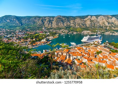 Kotor, Montenegro - September 23 2018: A massive cruise ship docks in the bay of Kotor in the ancient coastal city on the Adriatic Sea, Kotor, Montenegro.