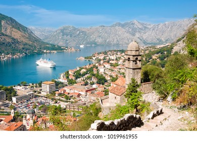 Kotor, Montenegro - September 27, 2012: Aerial view of historic Church of Our Lady of Remedy overlooking Kotor old town and bay. Copy space in blue sky.